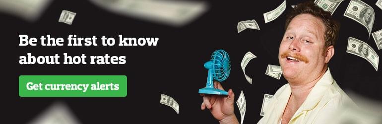 bernie holding fan blowing cash