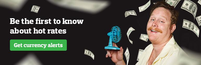 Man blowing money with fan