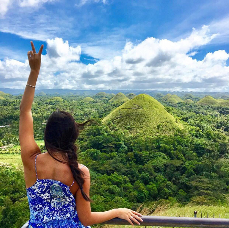 girl looking over chocolate hills