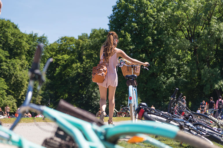 Girl in park with bike Germany