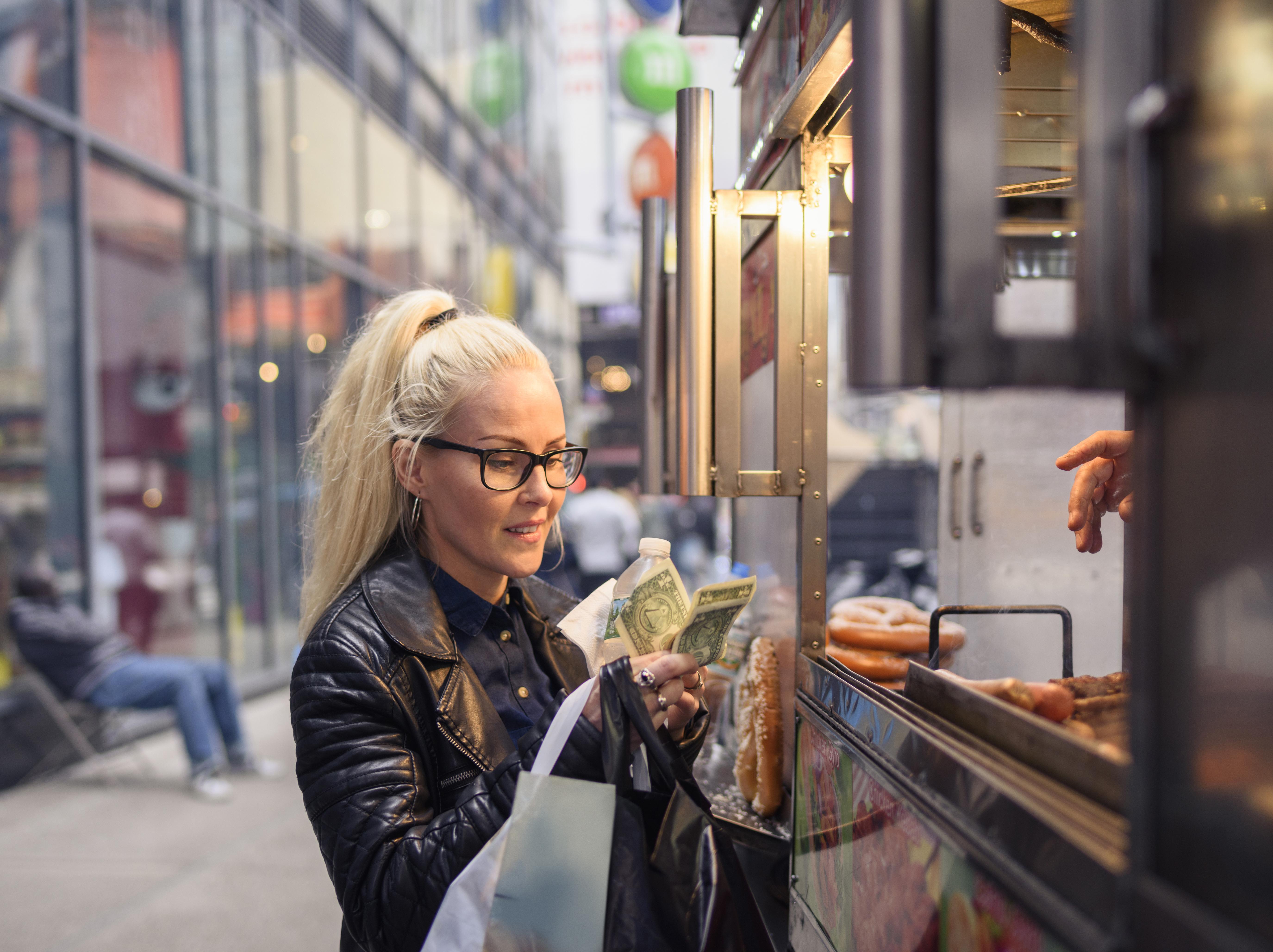 buying hotdog in New York