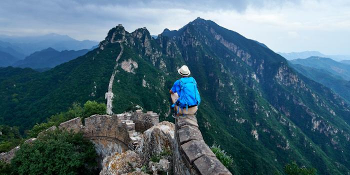 Man sitting at Great Wall of China