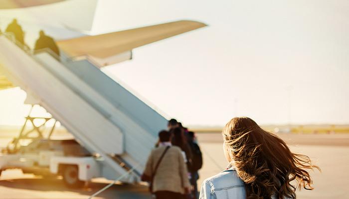 girl boarding plane