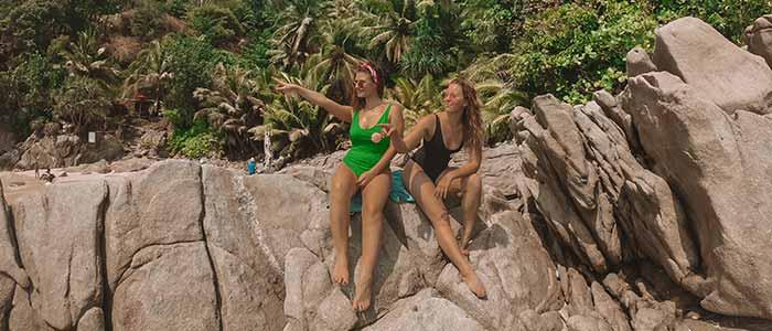 Girls sitting on rock