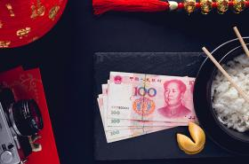 Chinese Yuan notes, rice and fortune cookie