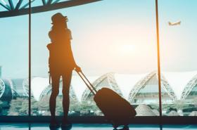 Woman looking out airport window