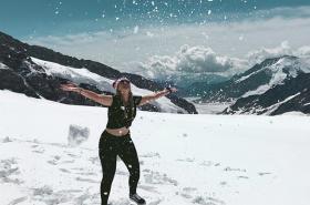 Girl on snowy mountain