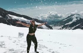Girl on snowy mountain