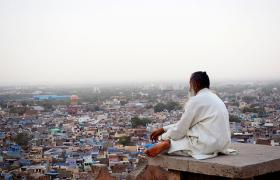 Man overlooking Indian city