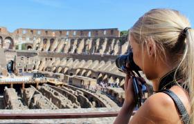 Girl taking photo in colosseum