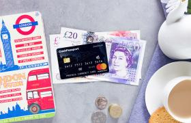 Great British Currency with travel money card and cup of tea